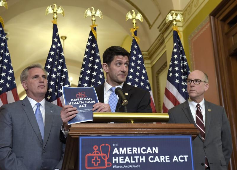 House Speaker Paul Ryan of Wis., center, standing with Energy and Commerce Committee Chairman Greg Walden, R-Ore., right, and House Majority Whip Kevin McCarthy, R-Calif., left, speaks during a news conference on the American Health Care Act on Capitol Hill in Washington on March 7, 2017. (Susan Walsh/AP Photo)