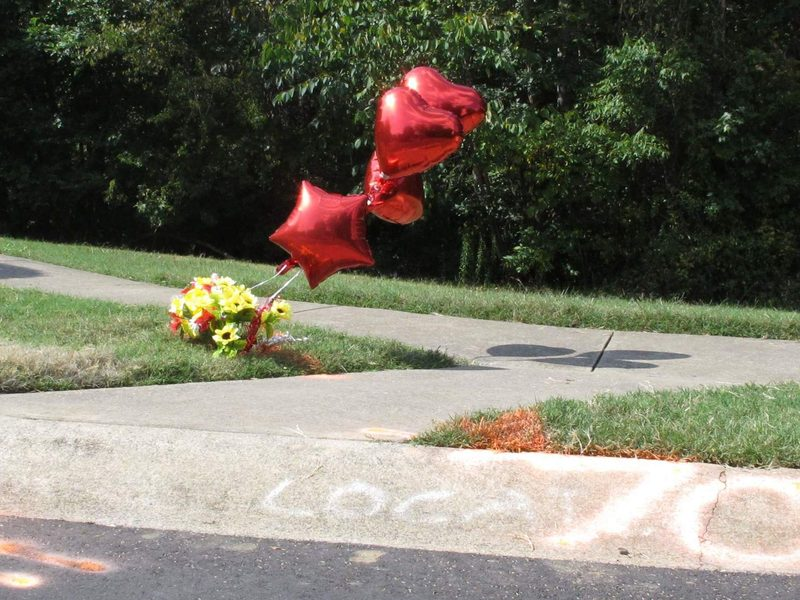 Flowers and balloons, along with spray-painted police markings, show the spot where Jonathan Ferrell was shot and killed by Charlotte-Mecklenburg Police in 2013. Officer Randall Kerrick was charged with voluntary manslaughter and investigators said Ferrell, who was unarmed, was shot 10 times.