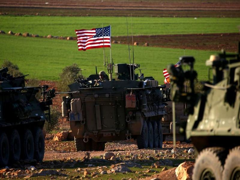 The Marines will join the approximately 500 U.S. troops already in Syria, such as these U.S. forces on the western outskirts of the northern Syrian city of Manbij on Sunday.