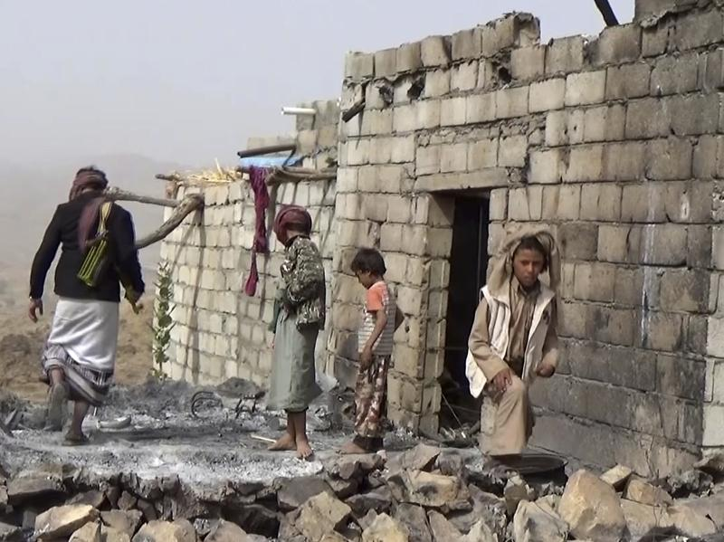 Yemeni residents inspect a house that was damaged during a Jan. 29 U.S. raid on the tiny village of Yakla, in central Yemen.