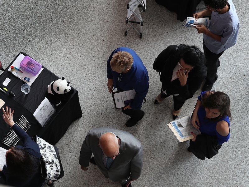 People attend the JobNewsUSA career fair Sunrise, Fla., in November 2016.