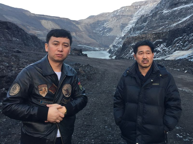40 year-old Longhua worker Wu Songtao and co-worker Wang Fuxiang stand at the bottom of their coal mine in Dalianhe. It's one of China's largest open-pit mines.