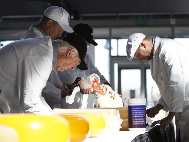 On Tuesday, William Wangerin (front) and three other judges consider cheeses at the U.S. Championship Cheese Contest in Green Bay, Wis. The contest organizer, Wisconsin Cheese Makers Association, says the number of cheeses, yogurts and butters competing at this year's event is at an all-time high.