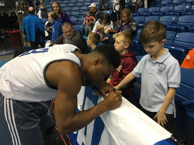 New Orleans Privateer guard Nate Frye signs autographs after a Monday practice at the University of Dayton Arena. Frye, a senior, joined the team when it was going through a difficult period of deciding whether it had the resources to compete in Division I.