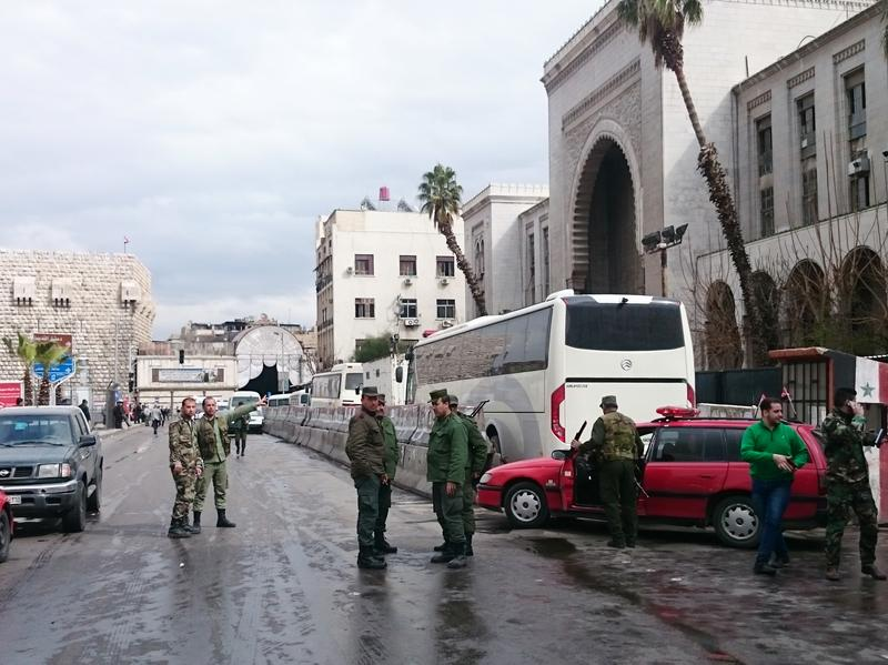 Syrian security forces cordon off the area following a reported suicide bombing at the old palace of justice building in Damascus on March 15, 2017.