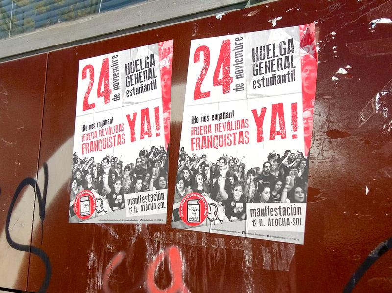 """Old posters on the wall of a school in San Cristóbal call on students to participate in a strike last November. The slogan warns, """"Get out of the way, Francoists!"""" Spain's experience of decades of dictatorship helps protect against an embrace of the right wing now. Calling someone a <em>franquista</em> — a follower of the late, right-wing dictator Francisco Franco — remains an insult."""