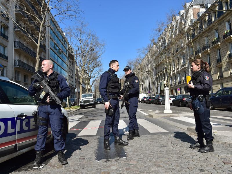 French police officers secure the scene near the Paris offices of the International Monetary Fund on Thursday, following reports that a letter bomb had exploded at the premises.