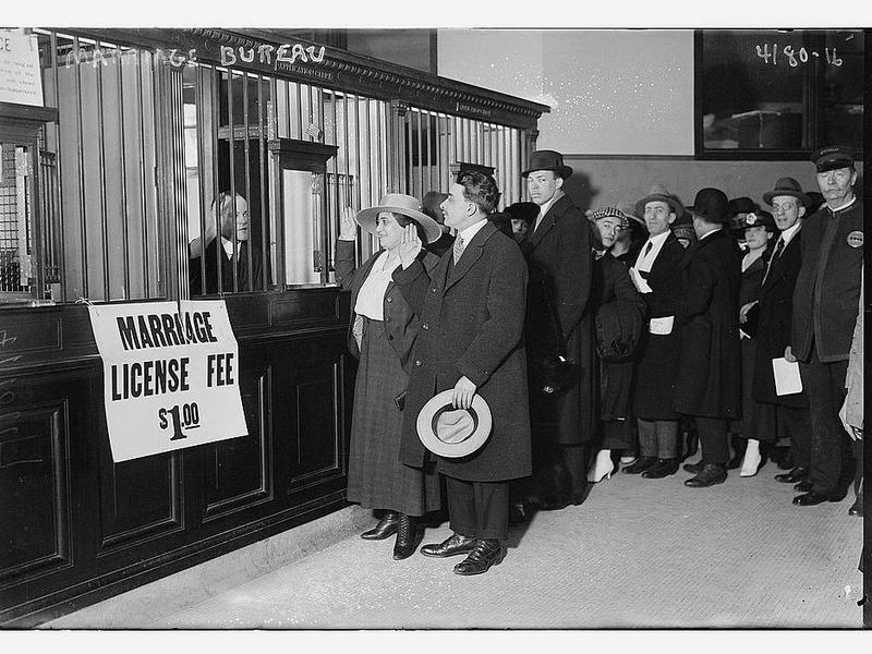 Couples stand in line to obtain their marriage licenses in this photograph, taken sometime between 1915 and 1920. The 1907 Expatriation Act would have affected people trying to get married during this time period — though the couples depicted in this photo were not necessarily affected by the Expatriation Act.