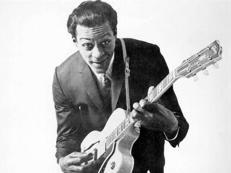 Chuck Berry in 1958, posing with his Gibson hollow-body electric guitar.
