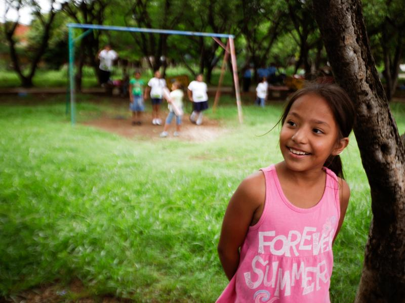 A girl in a park in Managua, Nicaragua. The country topped the list for gains in happiness.