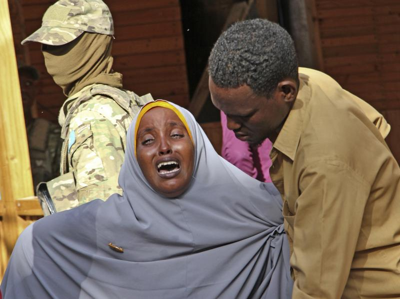 A woman grieves for her daughter, who was shot by militants during an attack on a restaurant in Mogadishu, Somalia. Early Thursday, Somali security forces ended a nightlong siege by al-Shabab extremists at the popular Pizza House restaurant in the country's capital.