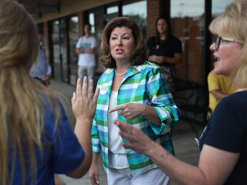 Republican candidate Karen Handel greets people during a campaign stop as she runs for Georgia's 6th Congressional District