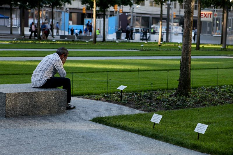 Visitors mourn at the 9/11 Memorial Plaza.