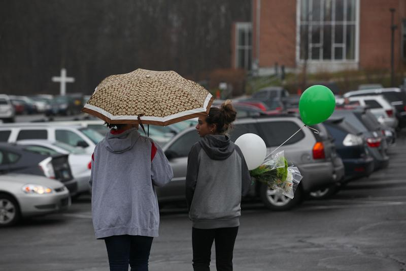 Families visit St. Rose church in Newtown, Conn., for Sunday mass, just two days after a deadly shooting at nearby Sandyhook Elementary School.