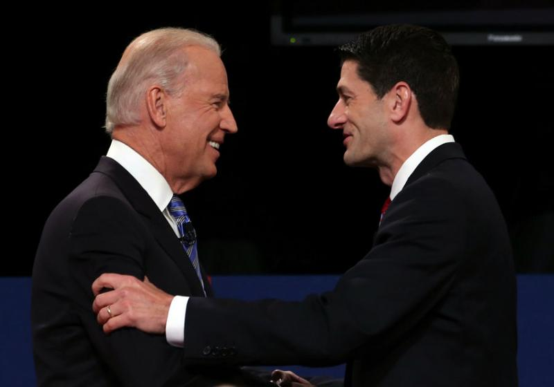 U.S. Vice President Joe Biden (L) shakes hands with Republican vice presidential candidate U.S. Rep. Paul Ryan (R-WI) (R) during the vice presidential debate.