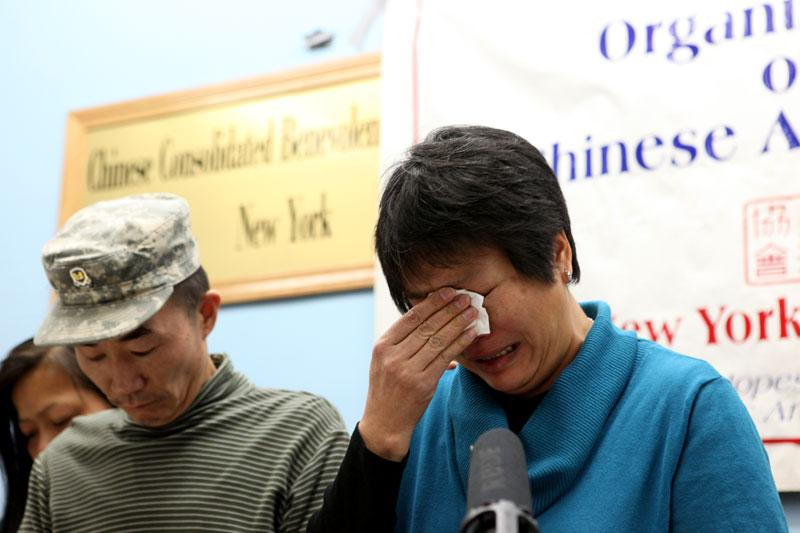 Pvt. Danny Chen's parents Yao Ten  and Su Zhen Chen speaking in Chinatown after the last courts-martial.