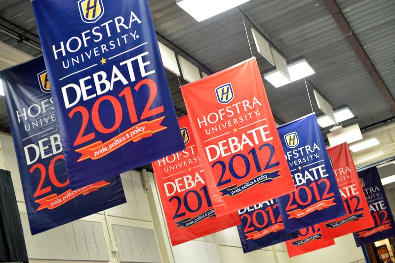 Banners hang at Long Island's Hofstra University, the site of the second debate between President Barack Obama and Republican nominee Mitt Romney.