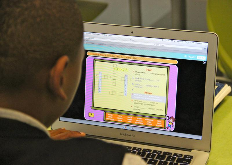 A student working at a computer at Merit Prep Academy