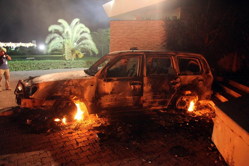 A vehicle sits smoldering in flames after being set on fire inside the American consulate compound in Benghazi late on September 11, 2012.