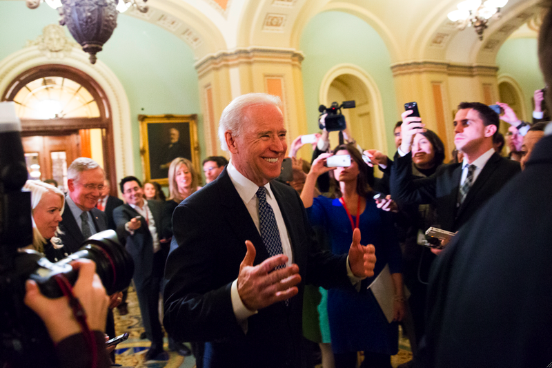 Vice President Joe Biden urged Senate Democrats to support a tentative tax agreement with Republicans in a closed-door meeting.