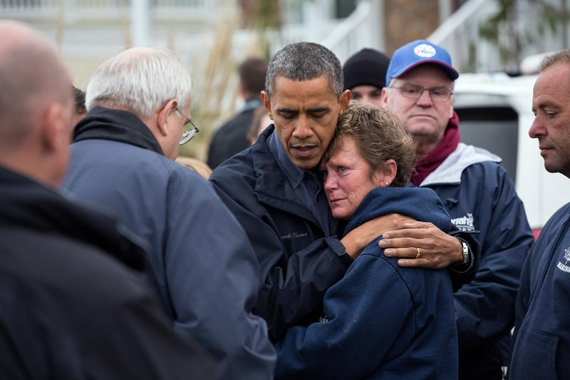 President Obama hugs Donna Vanzant, the owner of North Point Marina, as he tours damage from Hurricane Sandy in Brigantine, New Jersey.