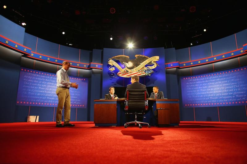 Stand-ins participate in a stage rehearsal a day ahead of the final presidential debate in Boca Raton.