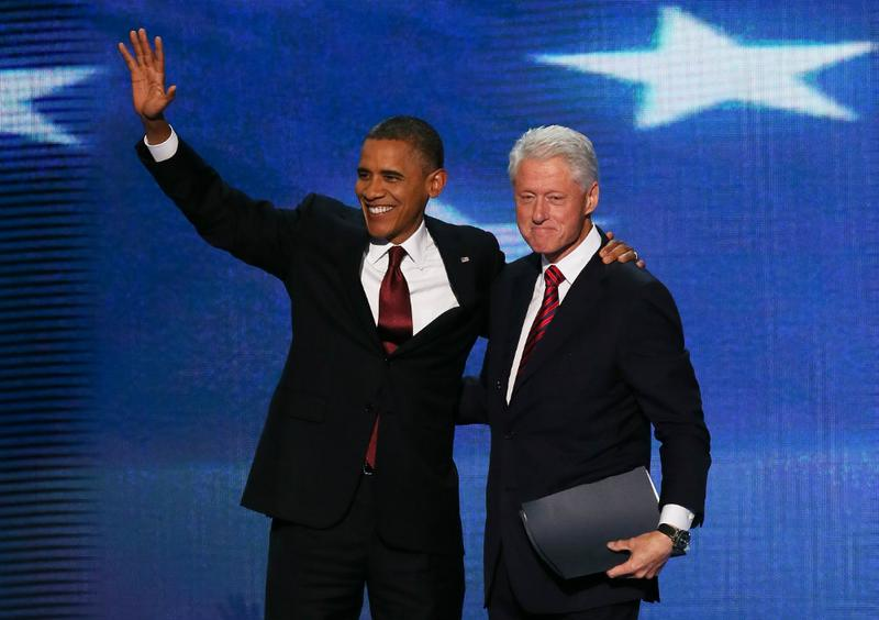 President Barack Obama joins former President Bill Clinton on stage after Clinton's speech at the Democratic National Convention.