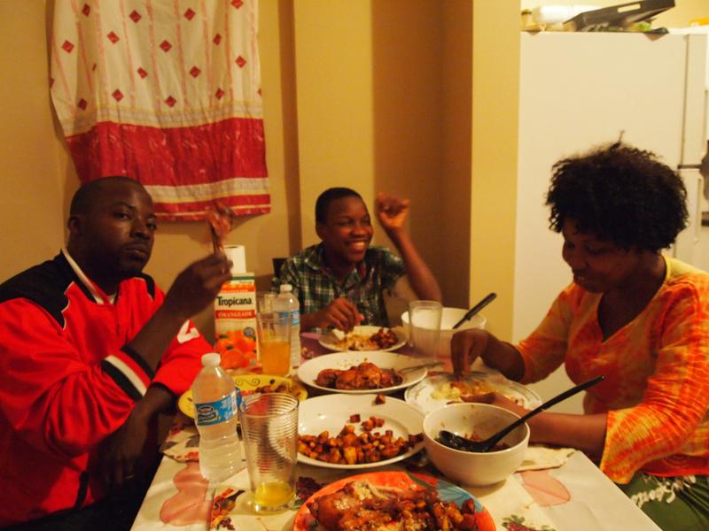 Cisse, Thierno and Rougui enjoying dinner