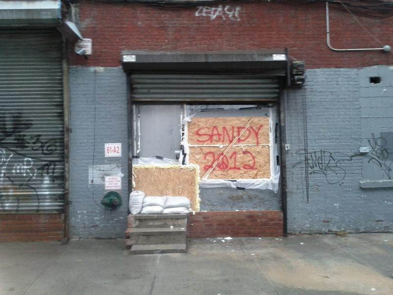 A sign for Sandy along 9th street near the Gowanus Canal Monday afternoon.