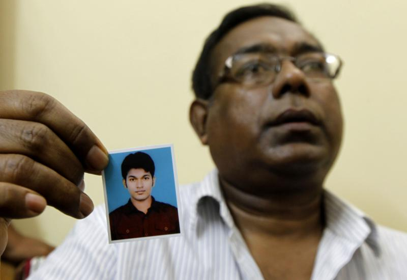 Quazi Mohammad Ahsanullah, the father of Bangladeshi national Quazi Mohammad Rezwanul Ahsan Nafis who was arrested in New York for attempting to detonate a bomb, holds a portrait of his son.