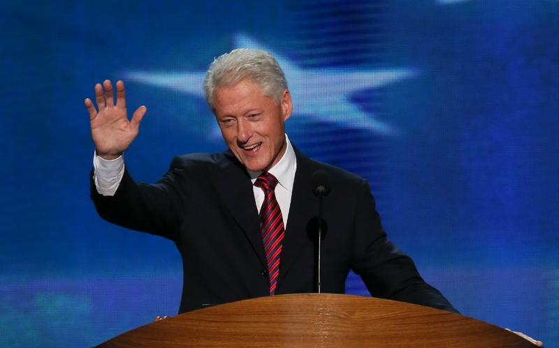 Former U.S. President Bill Clinton waves as he takes the stage during day two of the Democratic National Convention.