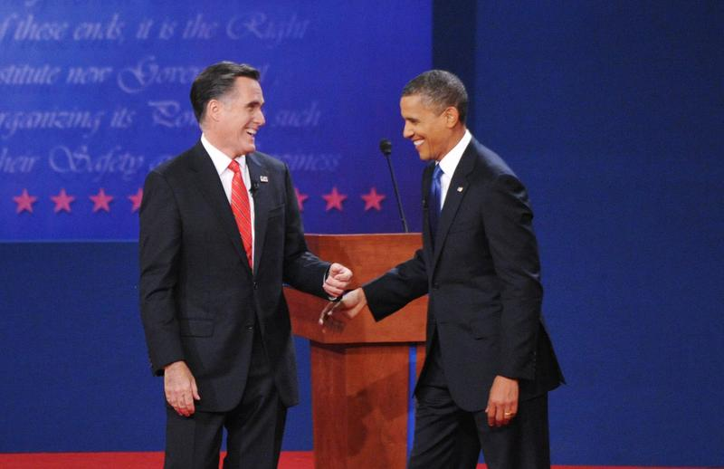 US President Barack Obama and Republican presidential candidate Mitt Romney share a laugh October 3, 2012 at the conclusion of the first presidential debate.