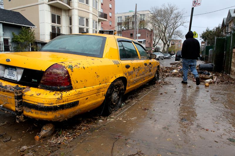 Destroyed taxi cab on Coney Island after Hurricane Irene