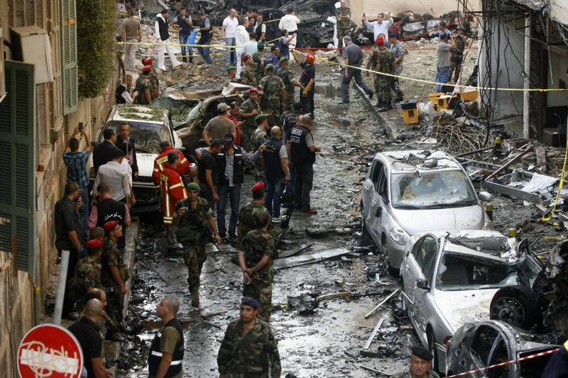 Lebanese security forces and rescue workers gather at the site of an explosion in Beirut's Christian neighbourhood of Ashrafieh on October 19, 2012.