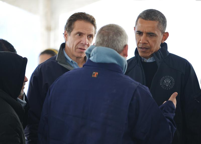 President Barack Obama and NY Gov. Andrew Cuomo talk with a man inside a FEMA distribution tent on Staten Island on November 15, 2012.