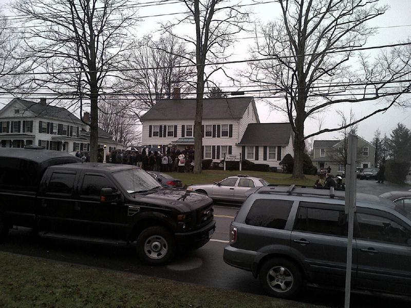 Mourners enter the funeral for 6-year-old Jack Pinto who was killed in the Sandy Hook Elmentary mass shooting.