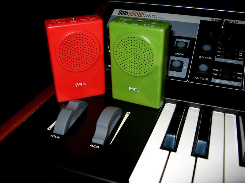 Red, green, and black audio equipment