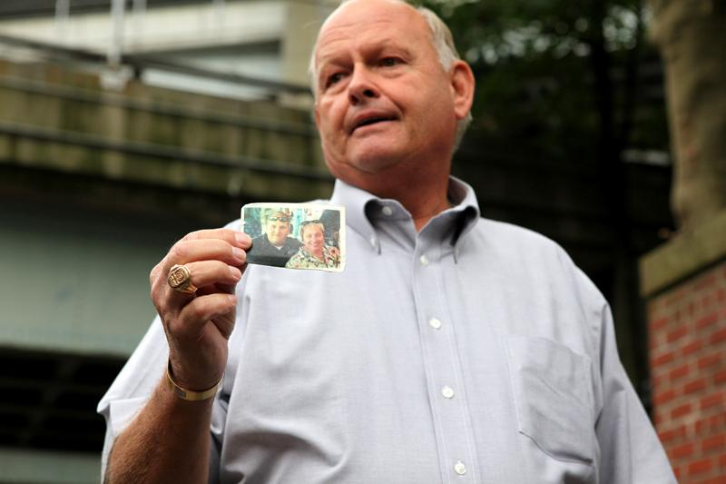 Kenneth Fairben shows a picture of his son Keith, who was killed on 9/11. Kenneth is watching the 9/11 Guantanamo Trials at Fort Hamilton in Dyker Heights, Brooklyn.