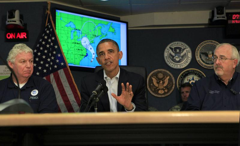U.S. President Barack Obama makes a statement after a briefing on Hurricane Sandy with Richard Serino (L), Deputy Administrator, FEMA, and Craig Fugate (R), Administrator FEMA at FEMA Headquarters.