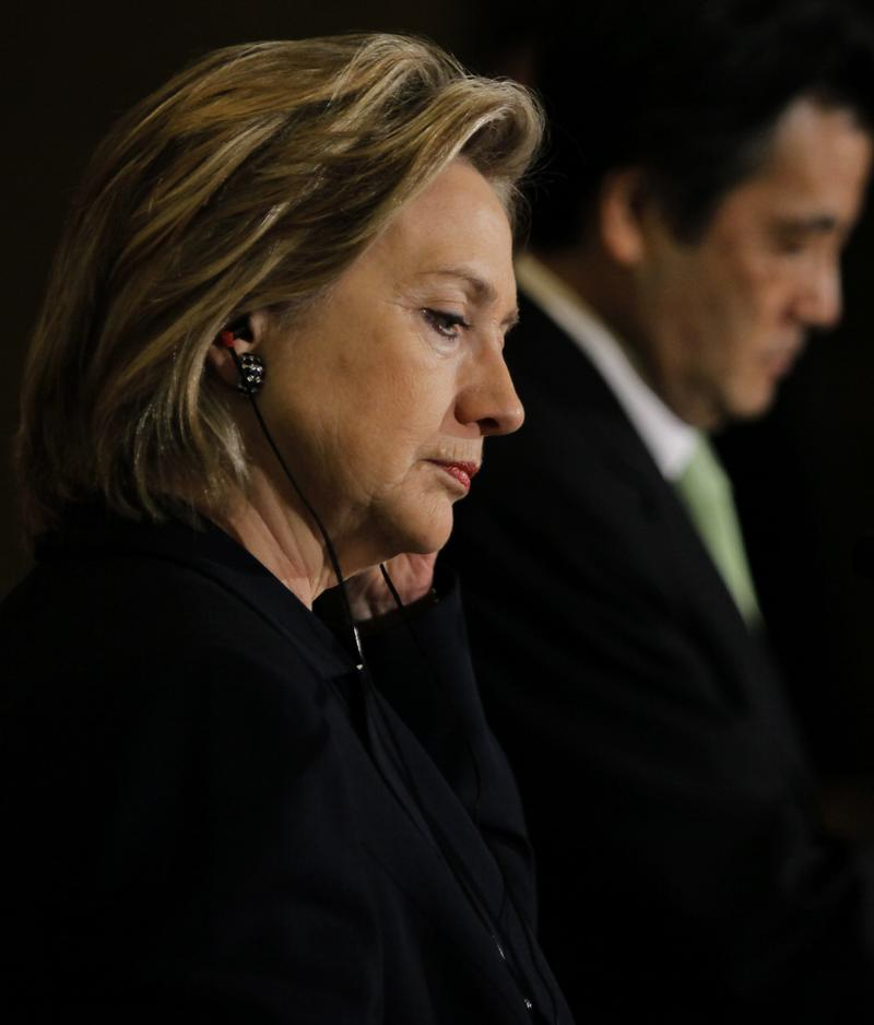 U.S. Secretary of State Hillary Rodham Clinton listens to her Japanese counterpart Katsuya Okada during a joint news conference,  May 21, 2010 in Tokyo, Japan.