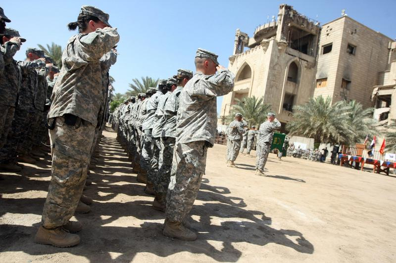 US soldiers salute during a handover ceremony of the 'entry control points' of Baghdad's Green Zone, now referred to as the International Zone, to Iraqi control on June 1, 2010.