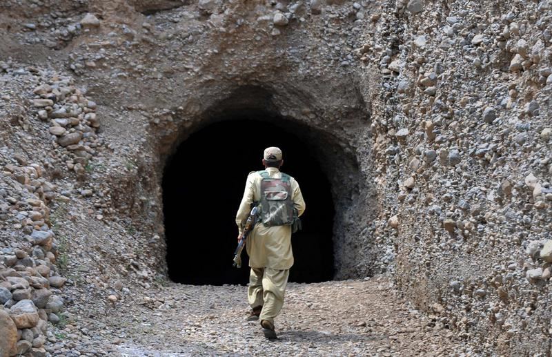 A Pakistani soldier enters a cave at a complex dug into rocky mountains which was used by Pakistani militants in northwestern Kurram tribal district close to the Afghan border on July 6, 2010.
