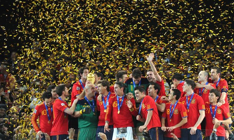 Spanish players celebrate with the trophy after the ceremony following the 2010 FIFA World Cup between the Netherlands and Spain on July 11, 2010 at Soccer City stadium in Soweto, South Africa.