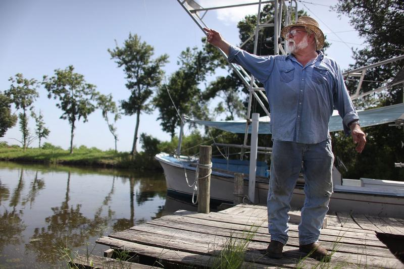 Shrimper Laveau Trudeau, Jr. stands next to his trawler in Plaquemines Parish July 13, 2010 in Wood Park, Louisiana. Trudeau has not been able to shrimp this year due to the BP oil spill.