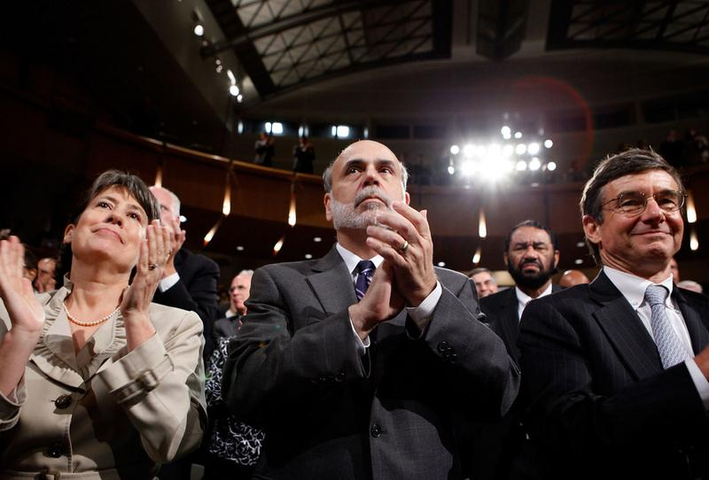 FDIC Chair Sheila Bair, Fed Reserve Bank Chairman Ben Bernanke and California Public Employees Retirement System CIO Joseph Dear applaud as President Obama signs the the financial reform bill, July 21