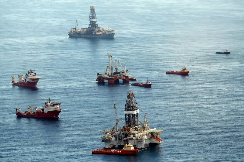 Ships assist in clean up and containment near the source of the BP Deepwater Horizon oil spill July 27, 2010 in the Gulf of Mexico off the coast of Louisiana.