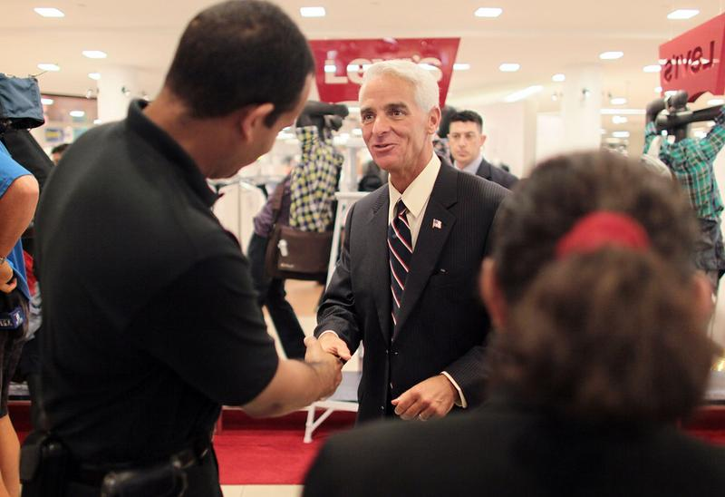 Florida Governor Charlie Crist is greeted while attending a Back to School Sales-Tax Holiday launch event at a Macy's department store August 12, 2010 in Miami, Florida.
