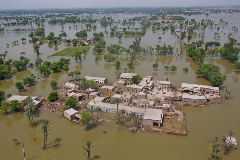 Houses are seen surrounded by flood waters from a Pakistan Army helicopter on August 22, 2010 in the village of Shah Jamaal west of Muzaffargarh in Punjab, Pakistan.