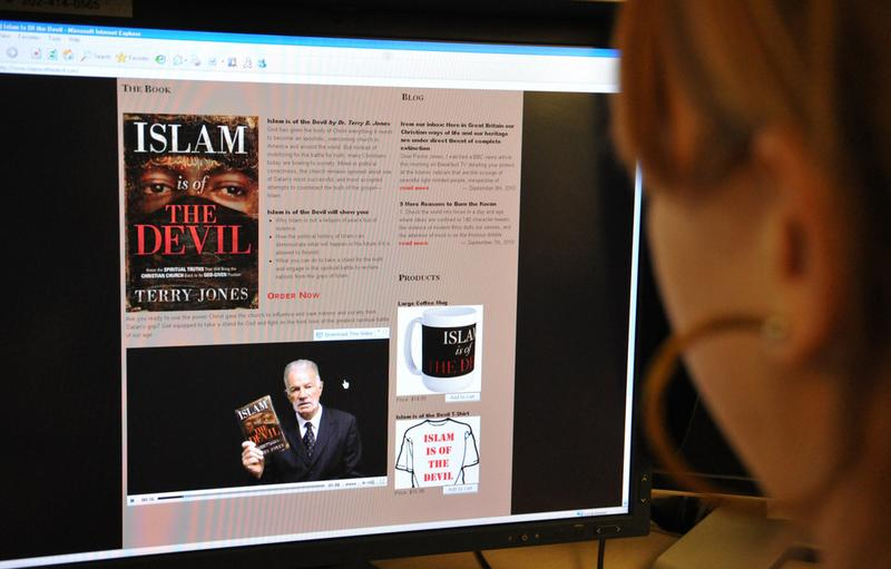 A journalist looks at the website 'Islam is of the Devil' featuring a book for sale written by Terry Jones, pastor of the Dove World Outreach Center, September 8, 2010