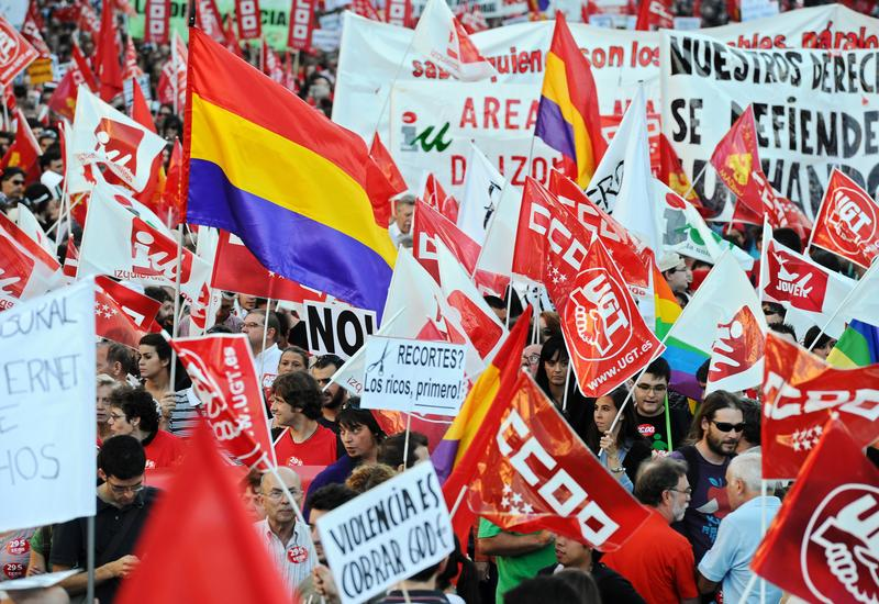 Protesters walk with banners and flags as they demonstrate at the end of a nationwide general strike day on September 29, 2010 in Madrid, Spain.